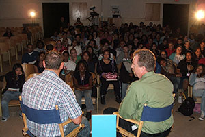 Discussion panel interacts with the crowd