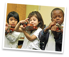 Three children tuning their violins