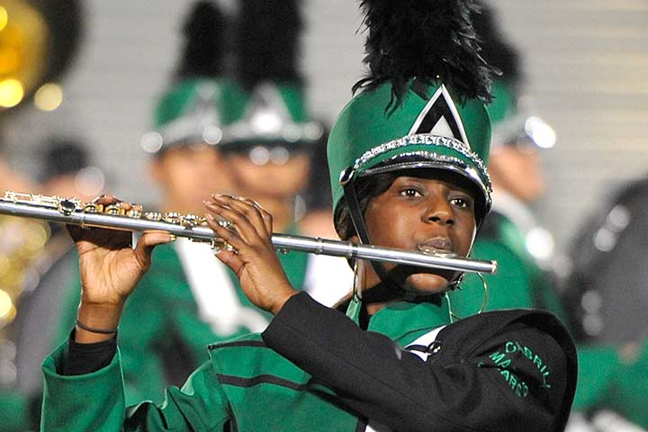 Cabrillo high school Band member marches, playing flute