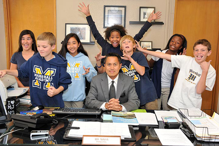 Principal poses with group of students