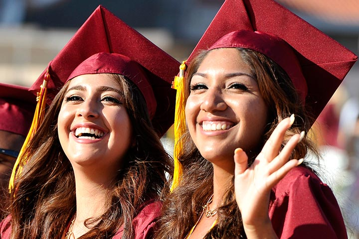 Two high school girls celebrate graduation
