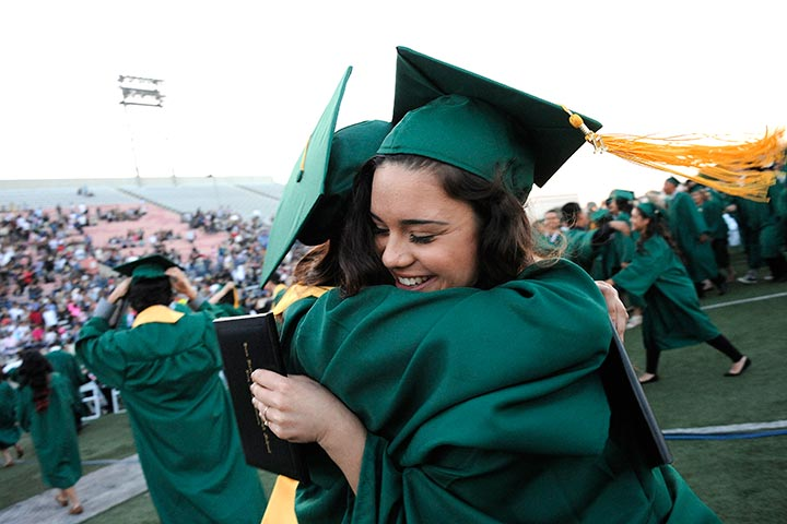 Two Cabrillo students hug at graduation