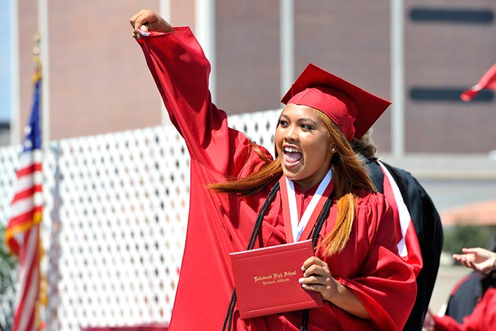 Lakewood student pumps fist at graduation