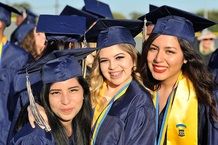 Three Millikan Graduates Pose