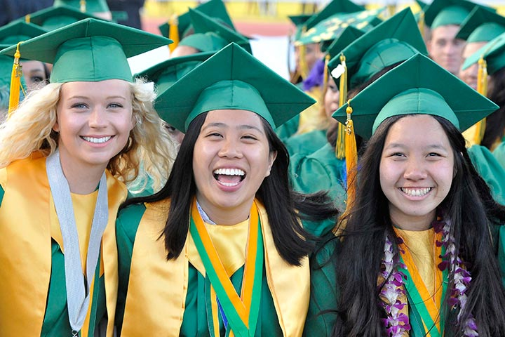 Three female Poly students smile for camera