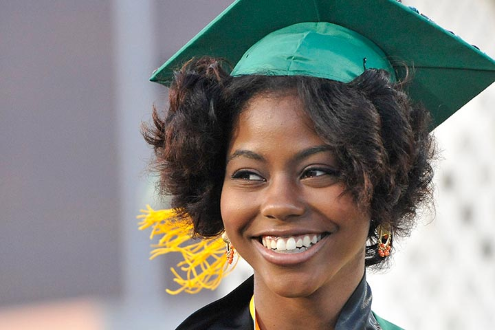 Female Poly student smiles at graduation
