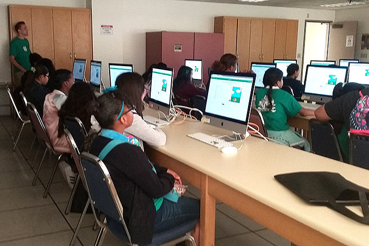 Students work on projects using comptuers