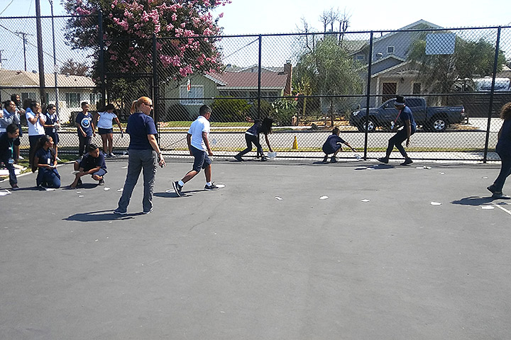 Student competing in outdoor activity with instuctors