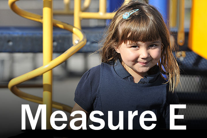 Measure E Logo with child in background