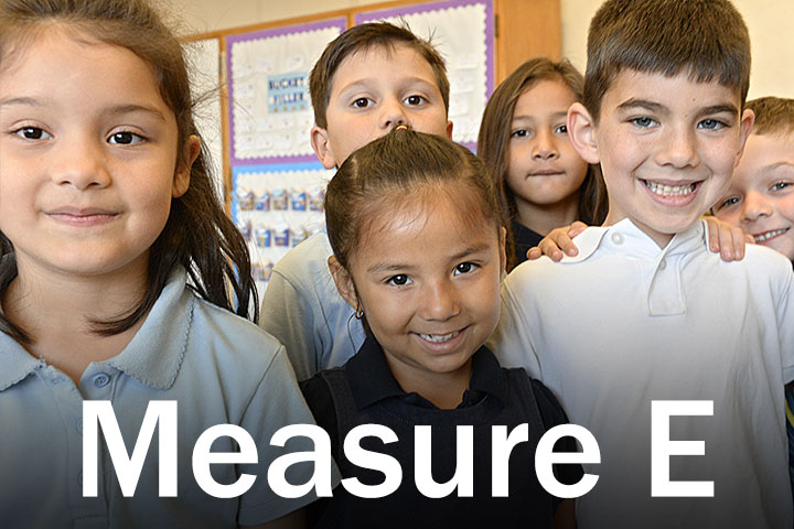 Measure E Logo with six children in background