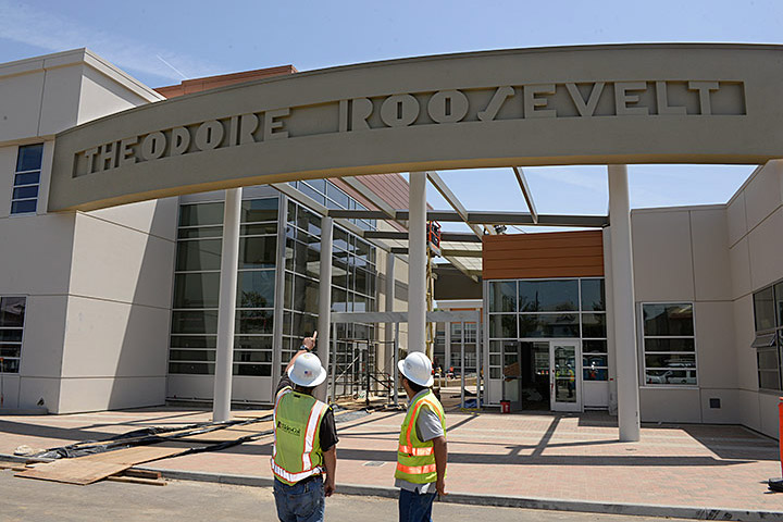 Construction workers look at newly designed Roosevelt school