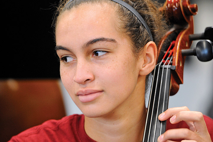 Wilson student plays instrument