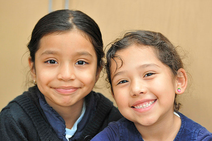 Two elementary girls posing for the camera