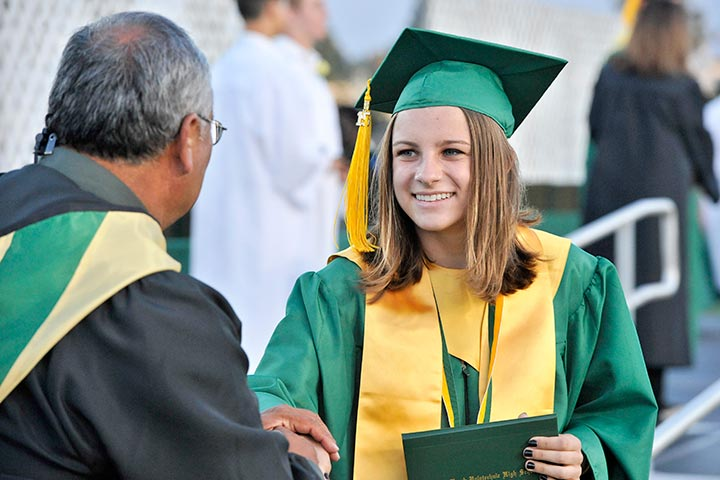 High School girl excepts her diploma