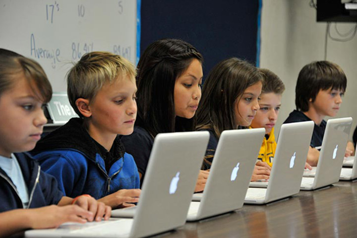 Middle school students at computers