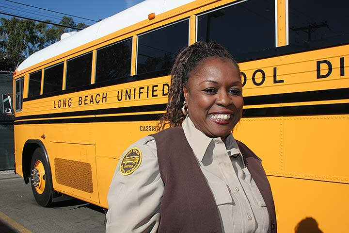 Story  Lbusd Bus Driver Poses In Front Of School Bus