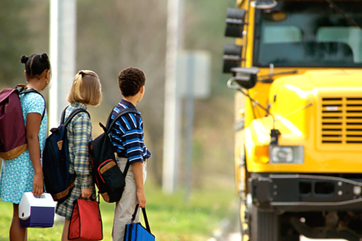 Students in line waiting to load onto school bus