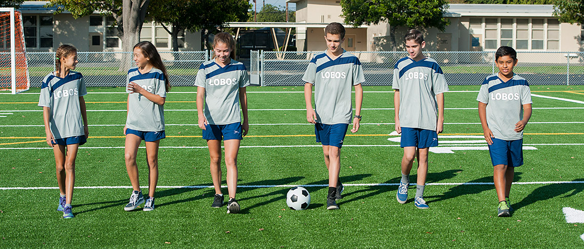 Keller Students on field with soccer ball