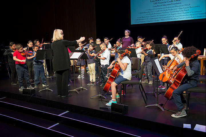 Student orchestra plays on stage