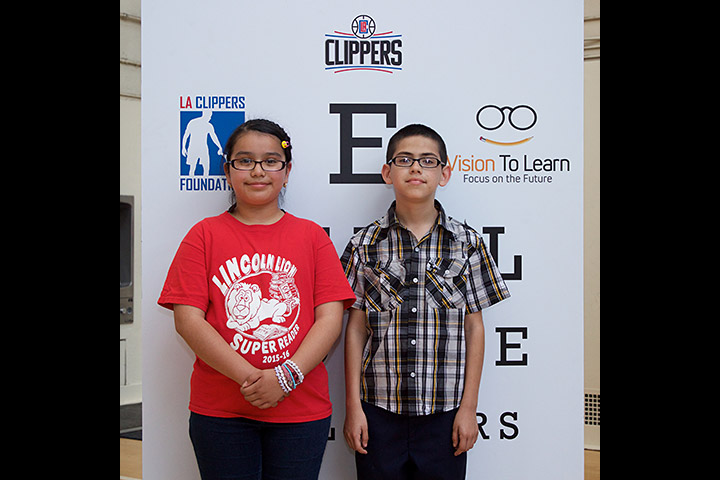 Two students show off their new glasses