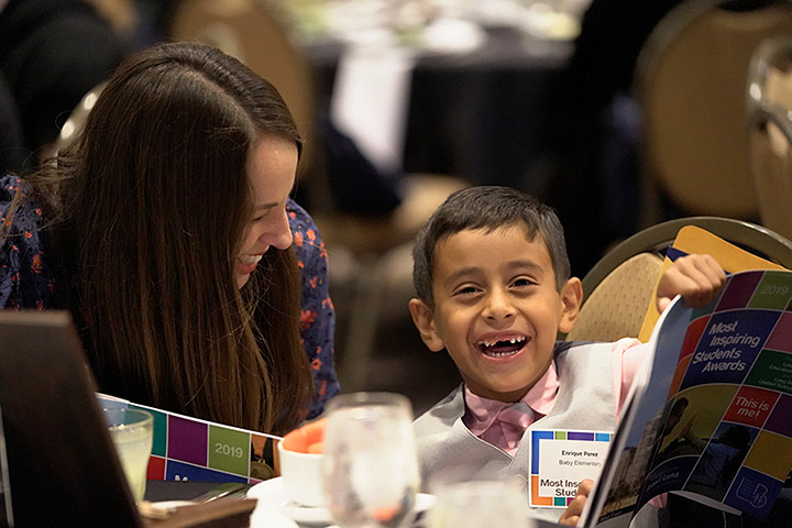 Student smiles at the MIS Dinner