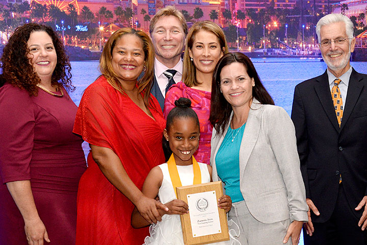 Zamora Arzu and family pose at MIS Awards event