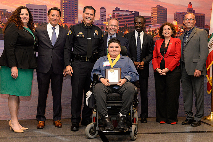 Inspiring student Diego Franco accepts his award.