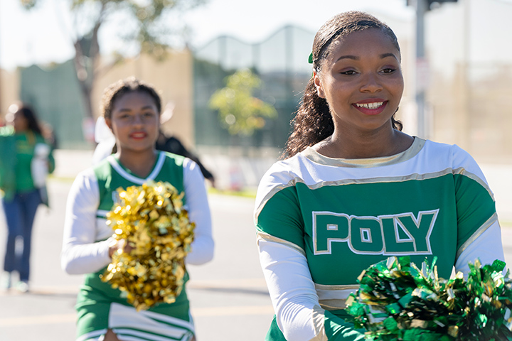 Members of Poly High School's cheer team participate in the parade.