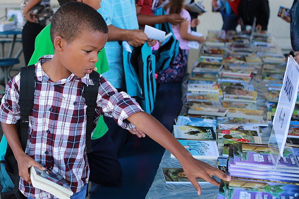 Powell Academy student selects free books.