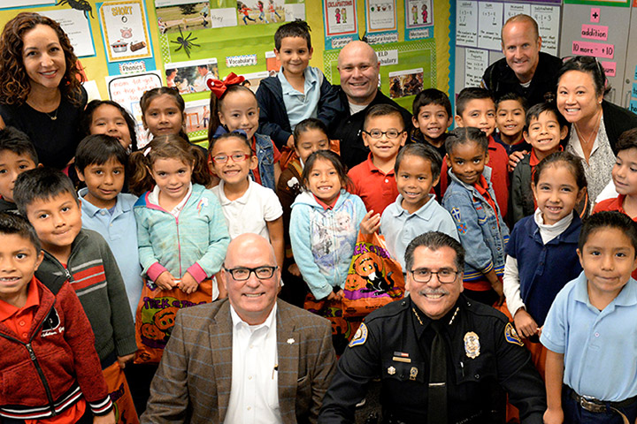 LB Police Chief Luna poses for a picture with Oropeza students