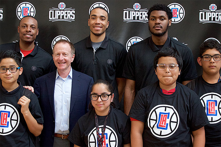 Group of students pose with Los Angeles Clipper players.