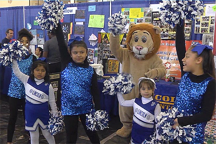 Lincoln Elementary students in cheer uniforms with lion mascot