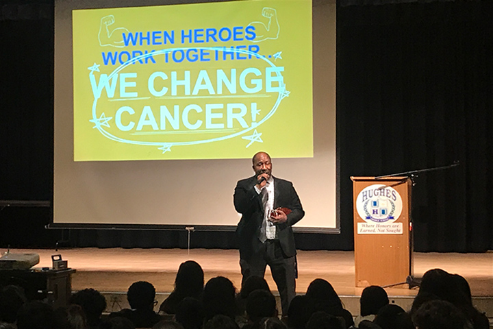 Hughes Middle School Principal Edward Samuels speaking at a school assembly