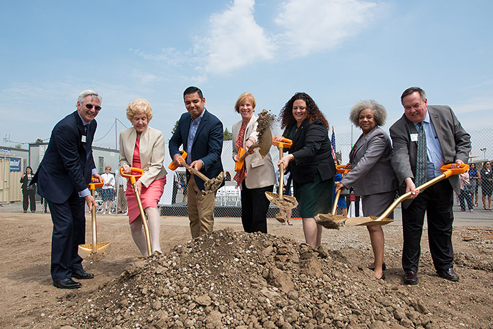Elected officials holding shovels on dirt lot of future Educare site
