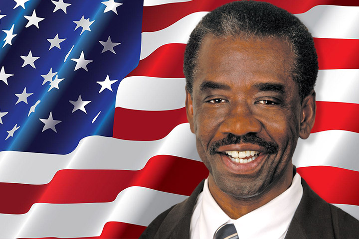 Board of Education Member Felton Williams with American Flag Background