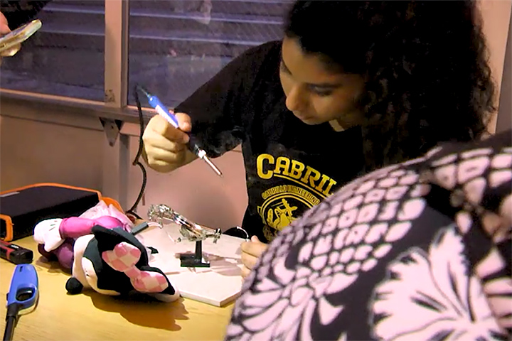 A student modifies a toy as part of Hack-a-Thon project.