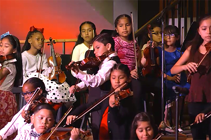 Students play instruments at Harmony Project concert