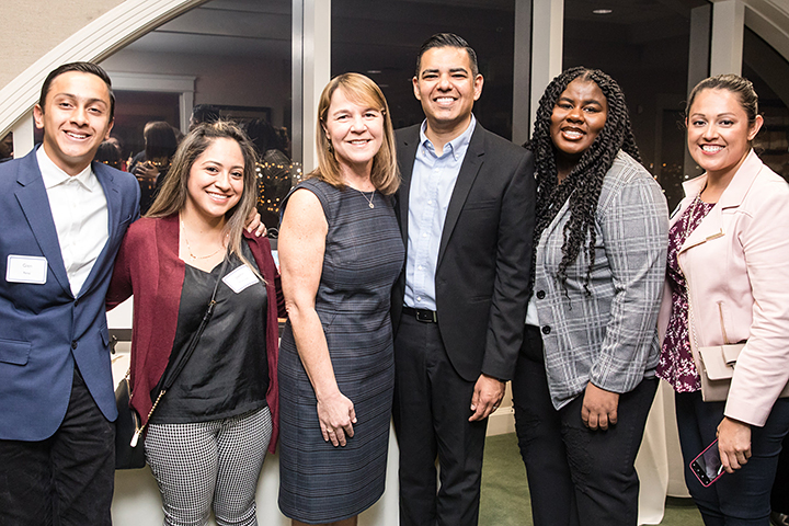 Jill Baker and Mayor Garcia, center, with other guests at the Feb. 27 event