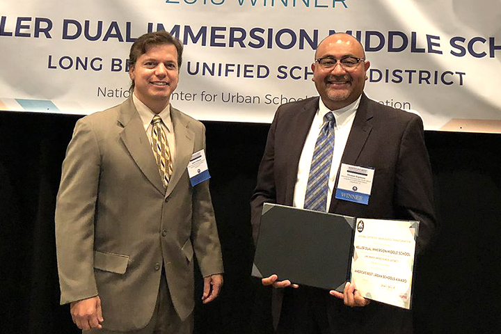 Keller Teacher James Orihuela and Principal Thomas Espinoza accept NCUST Award