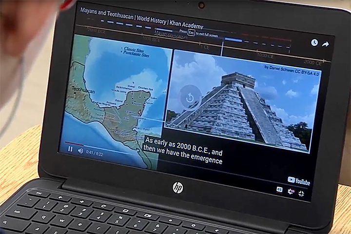 Laptop shows Khan Academy online tutorial on world history, with map of Mexico and image of Mayan pyramid.