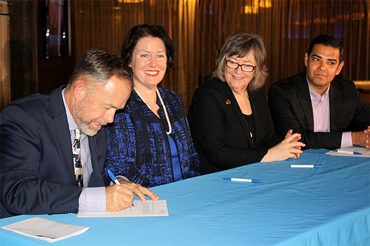 Leaders of four local institutions sign a renewed College Promise