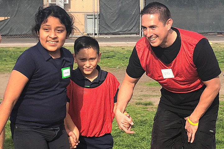 Long Beach Police officer Vic Feria interacts with students at Lincoln Elementary School.