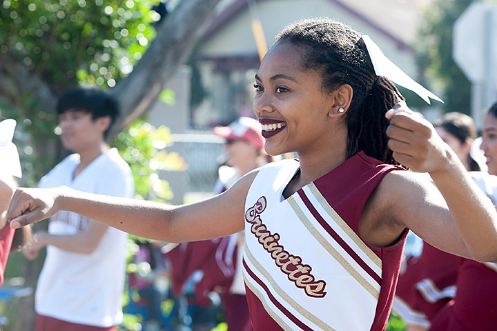 Long Beach Wilson color guard student marching in the MLK parade.