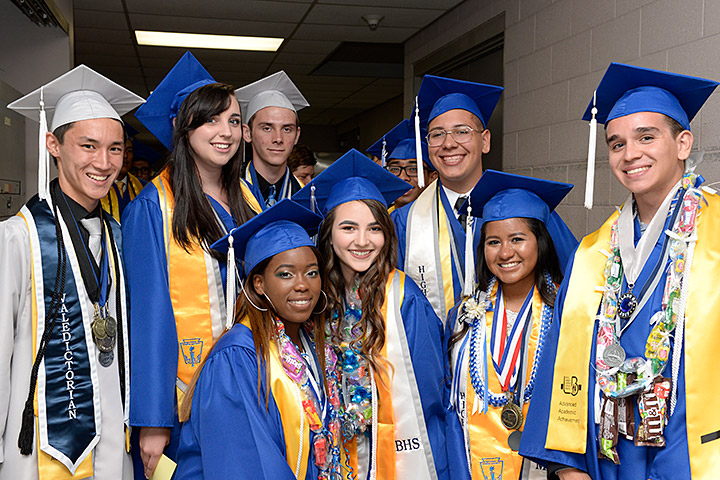 Eight McBride students pose at graduation