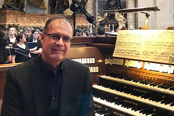 James Petri seated at the pipe organ in St. Peter's Basilica at the Vatican.