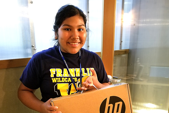 Franklin Middle School student Nicole Sise receives a Chromebook.