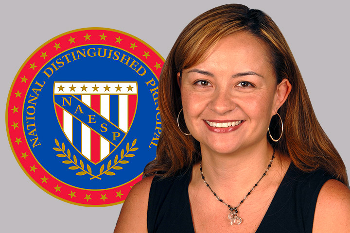 Alvarado Principal Lucy Salazar and backdrop of National Distinguished Principal Logo