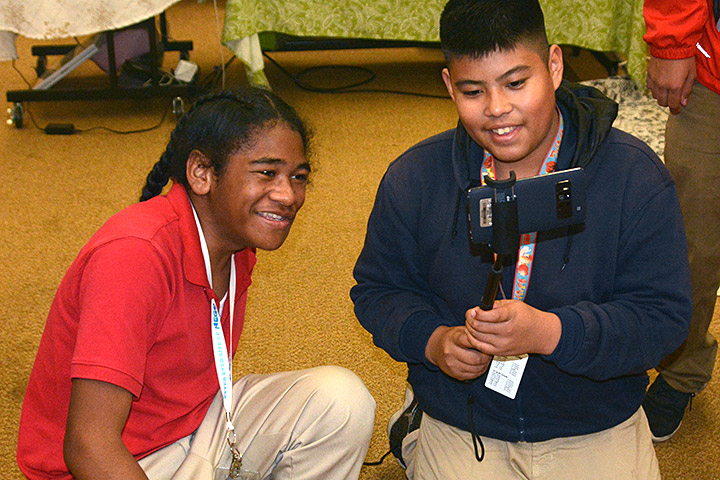 Two Washington Middle School students in class work together.