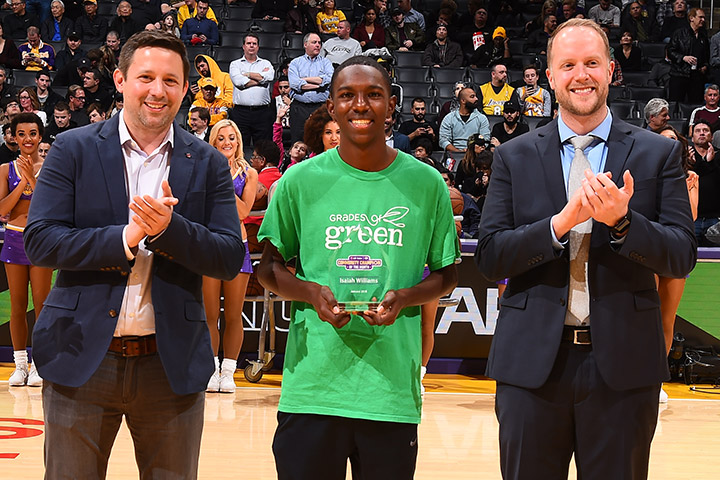 Student Isaiah Williams receives his award on the court at Staples Center.